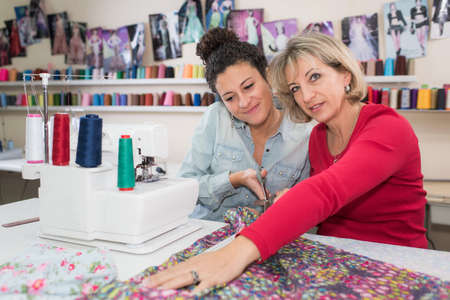 mom teaches daughter how to sew
