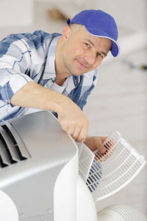 an aircon maintenance male worker