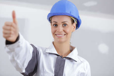 female builder with thumbs-up