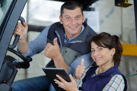 forklift driver and female supervisor showing thumbs up