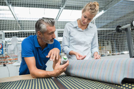couple of fashion designers working in a textile factory Banque d'images