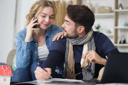 beautiful young couple is planning new house Stock Photo