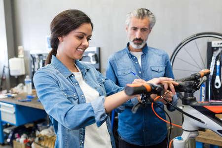 woman testing the repaired bike breaks Zdjęcie Seryjne
