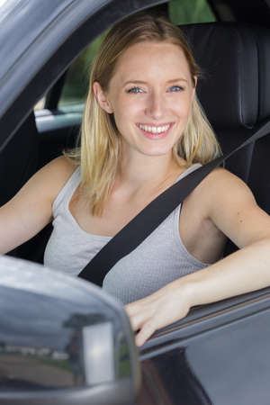 happy smiling woman inside of a car 写真素材