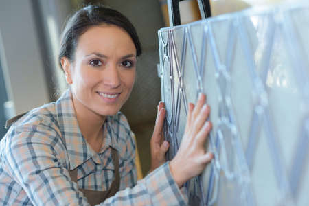 Portrait of artist with lead glass creation Stock Photo