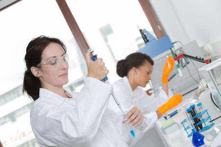 two young female scientist doing experiments in lab