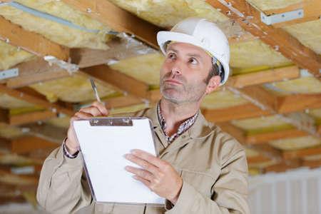 male inspector assessing property under renovation Stockfoto