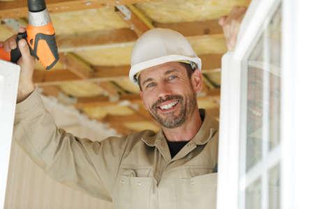 portrait of a smiling window fitter Stock fotó