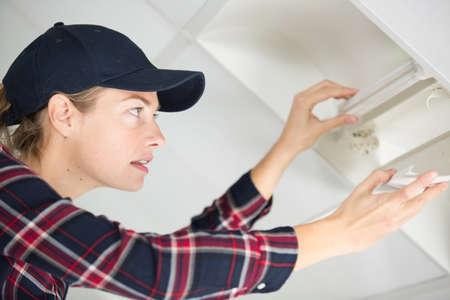 a woman looking at damage Reklamní fotografie