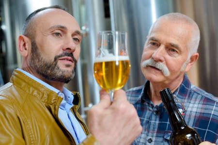 man looking at craft beer Фото со стока