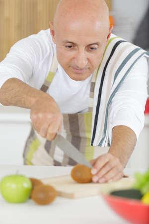 man preparing a healthy vegetarian meal