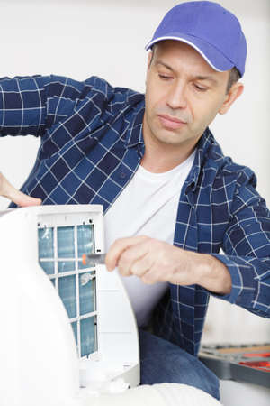 a technician working on airconditioning