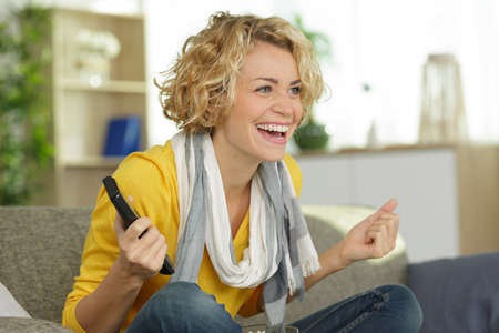 excited woman winning online prize