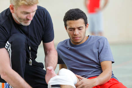 a football player with knee injury Stockfoto