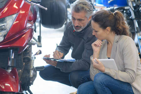 mechanic giving diagnostic details to client