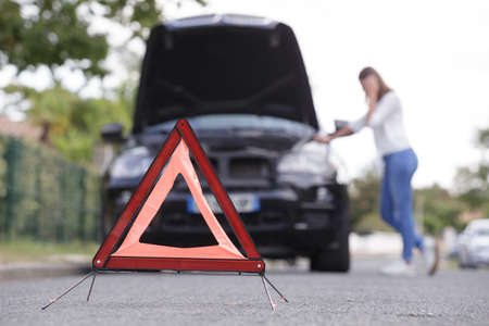 problems car and red triangle on the road