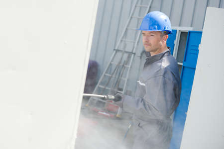 a male worker during termite control Stock Photo