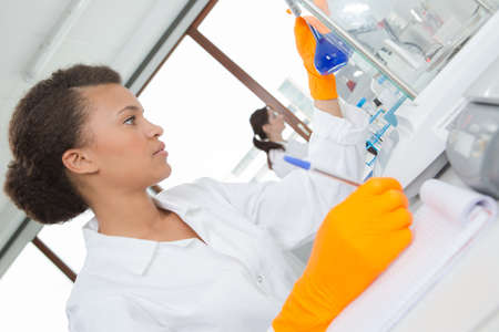 portrait of a young woman scientist in a laboratory
