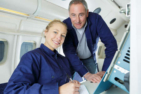 two modern aircraft engineers looking at camera