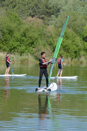 guy windsurfs on the lake