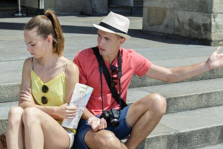 young boyfriend trying to explain to grumpy girlfriend