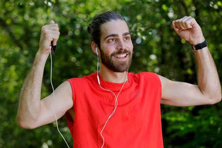 portrait of happy runner listening to music