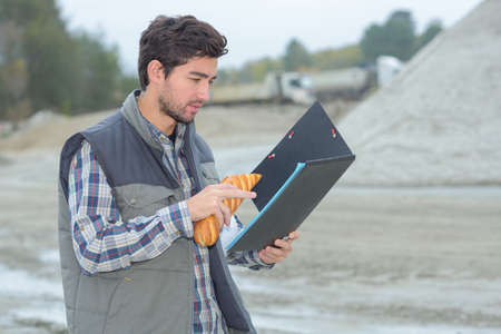 male worker reading the plan details