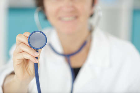 a female doctor using a stethoscope