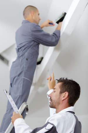 repairmen working with drawings on renovation