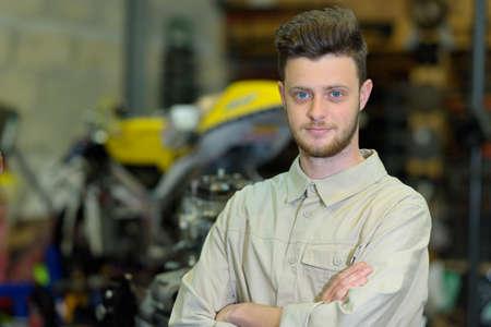 motorcycle mechanic looking at camera