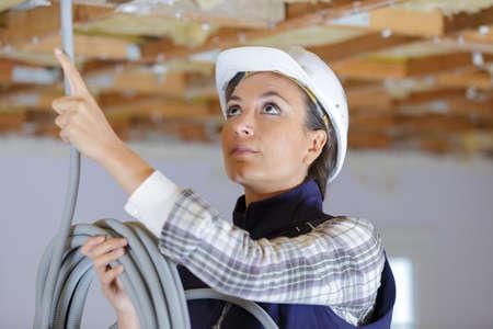 a woman electrician at work Reklamní fotografie