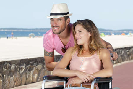 man and his disabled wife at the seaside