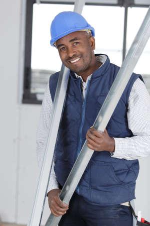 happy man holding wires indoors