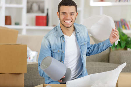 a young man moving houses