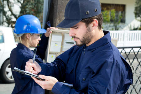 electrician engineers inspecting electric counter equipment