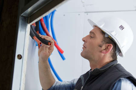 male electrician checks its serviceability