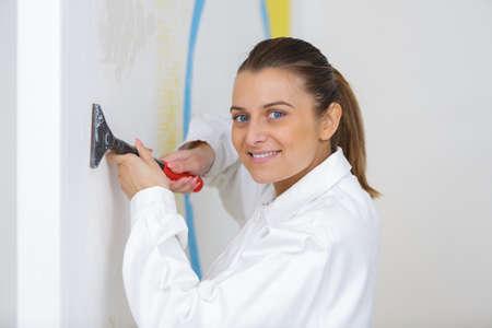 portrait of a happy female plasterer painter
