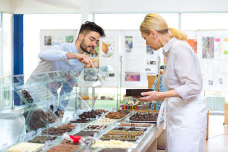 a man is buying chocolates