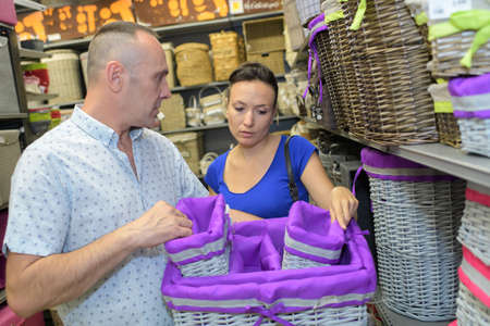 couple buying baskets in a store Banco de Imagens