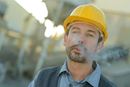builder worker smoking 스톡 콘텐츠