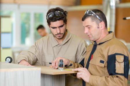 portrait of men in wood shop