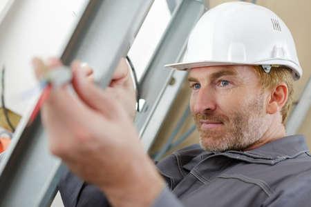 builder fixing up the framework 写真素材