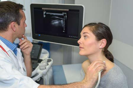 woman having neck ultrasound