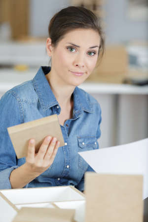 frustrated woman with self assembly furniture Standard-Bild