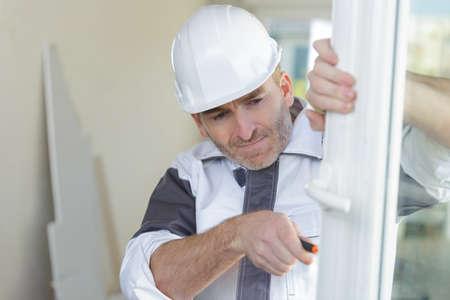 double glazing window installer fixing some defect
