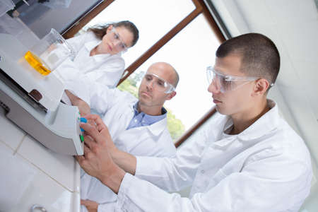 young researchers working with chemical liquid in the laboratory