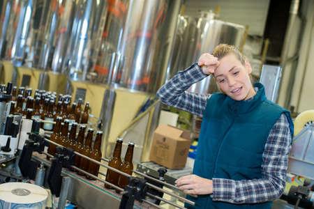 worker of a bottler factory Stock Photo