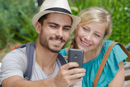 couple in love taking selfies outdoors