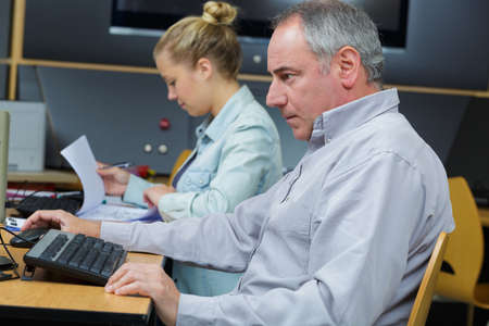man working with female colleague