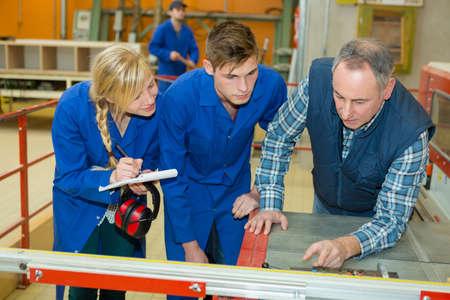 young apprentices in metalworkshop